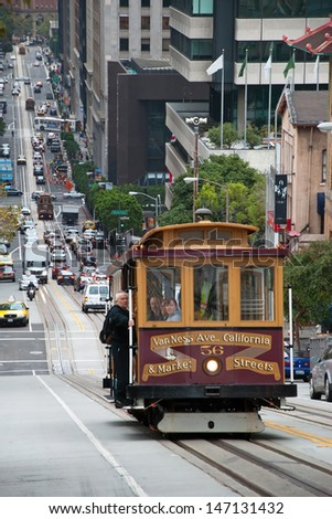 SAN FRANCISCO - OCTOBER 20, 2011: Cable car tram October 20, 2011 in San Francisco, USA. The San Francisco cable car system is world last permanently operational manually operated cable car system. - stock photo