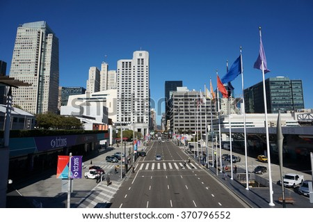 SAN FRANCISCO - OCTOBER 11:  Taxi and Cars on Howard Street with people walking around during tct2015 event at convention center in San Francisco on October 11, 2015. - stock photo
