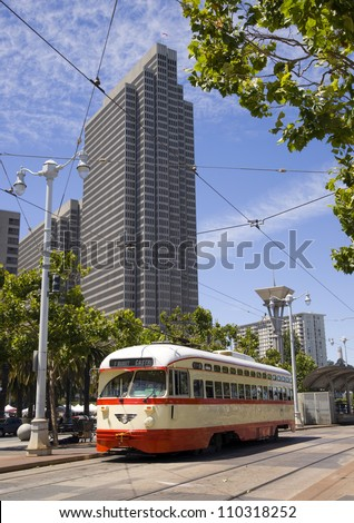 San Francisco overhead cable Trolley Car moves through the street downtown - stock photo