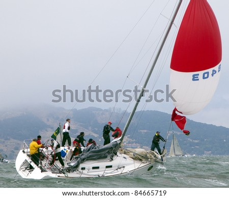 SAN FRANCISCO - SEPT 10: RolexBig Boat Series, Race 5, Sept 10, 2011 in San Francisco. Summer and Smoke, a Beneteau 36.7 in trouble with their spinnaker. - stock photo