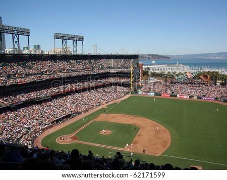 SAN FRANCISCO - SEPTEMBER 30: Diamondbacks vs. Giants: Giants Madison Bumgarner steps to throw with runner on 1st taking lead. taken on September 30 2010 at Att Park in San Francisco California. - stock photo