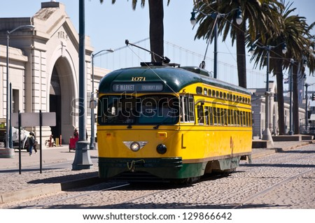 SAN FRANCISCO � SEPTEMBER 11: Vintage streetcars transport visitors along the Embarcadero and Fisherman's Wharf in San Francisco on September 11, 2012. - stock photo