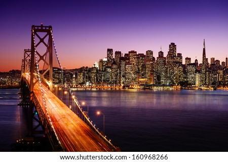 San Francisco skyline and Bay Bridge at sunset, California - stock photo