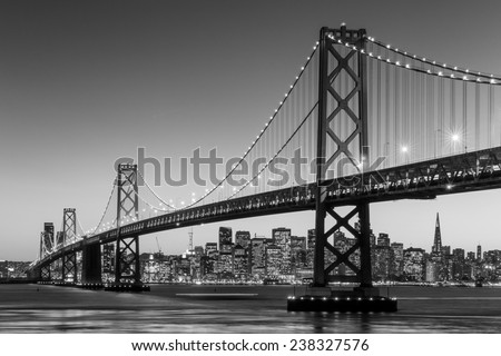 San Francisco skyline and Bay Bridge at sunset in black and white - stock photo