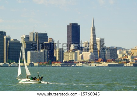 San Francisco Skyline with yacht sailing in the Bay - stock photo