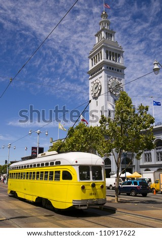 San Francisco Trolley Car moves through the street in California - stock photo