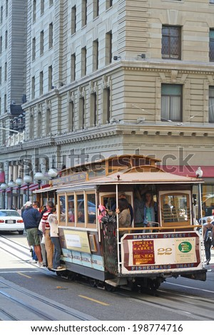 SAN FRANCISCO, USA - AUGUST 28, 2006: Passengers enjoy a ride in a cable car. It is the oldest mechanical public transport in San Francisco operated since 1873. - stock photo