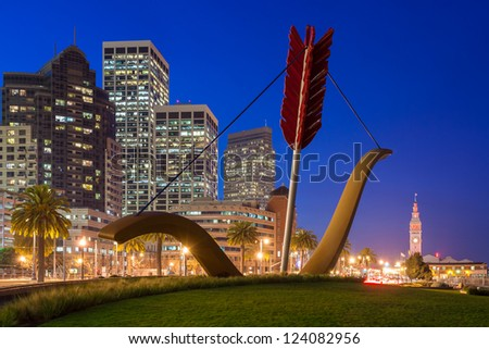 SAN FRANCISCO, USA - JAN 8: Cupid's Span statue by famous artists Claes Oldenburg and Coosje van Bruggen in Rincon Park with the city as a backdrop, on January 8, 2013 in San Francisco. - stock photo