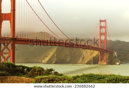 SAN FRANCISCO,USA - MARCH 1 2014: The famous Golden Gate Bridge in California,United States of America.View of the the red suspended bridge connecting Frisco to Marin County at sunset. - stock photo