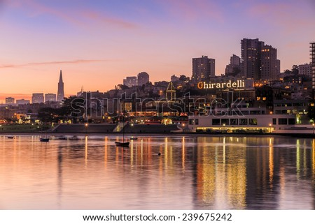 SAN FRANCISCO, USA - November 4:  Ghirardelli Square at sunset on October 4, 2014 in San Francisco, CA. It's a landmark public square with shops and restaurants in the Fisherman's Wharf  - stock photo