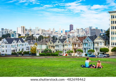 San Francisco, USA - September 24, 2015:  The colored traditional houses of Alamo square with the cityscape on background