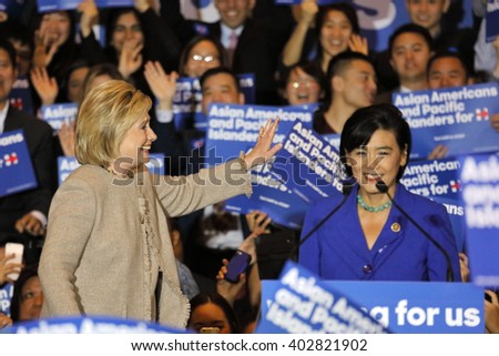 SAN GABRIEL, LA, CA - JANUARY 7, 2016, Presidential candidate Hillary Clinton stairs at crowd at Asian American and Pacific Islander (AAPI) members,while Representative Judy Chu speaks at podium.