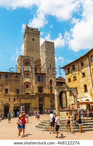 San Gimignano, Italy - July 05, 2016: town center of San Gimignano with unidentified people. The medieval town with its unique tower buildings is listed under the UNESCO World Heritage sites
