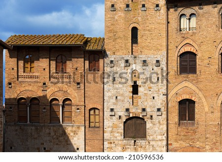 San Gimignano - Siena Tuscany Italy / Tower Chigi and Buildings in Piazza del Duomo, San Gimignano medieval town (UNESCO heritage), Siena, Tuscany, Italy - stock photo