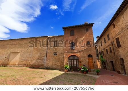San Gimignano - Siena Tuscany Italy / Typical buildings in San Gimignano medieval town (UNESCO world heritage site), Siena, Tuscany, Italy - stock photo