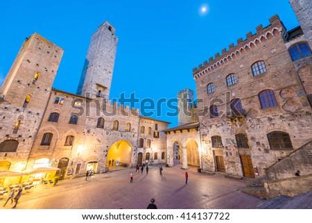San Gimignano, Tuscany. Sunset light over medieval architecture. - stock photo