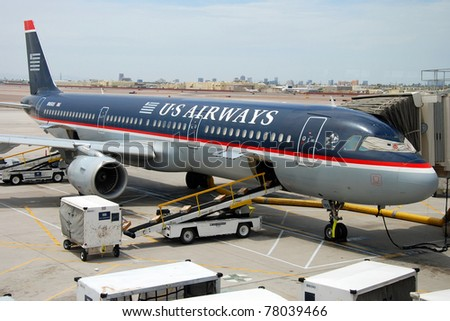 SAN JOSE - CIRCA JUNE 2009: US Airways boeing airplane on San Jose airport circa June 2009 in San Jose, USA. US Airways operates 3,310 flights a day to 200 destinations in 30 countries. - stock photo