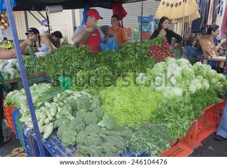 SAN JOSE, COSTA RICA - AUGUST 31, 2008: Market Vendors selling vegetables on farmers market in San Jose, Costa Rica. This is a traditional way of selling agricultural products. - stock photo