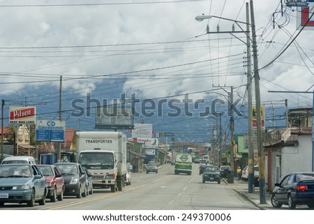 SAN JOSE, COSTA RICA - AUGUST 31, 2008: Traffic jam and parking cars on main street in San Jose, Costa Rica. San Jose is a modern city with bustling commerce and tourism industry. - stock photo