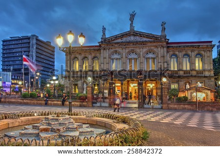 SAN JOSE, COSTA RICA - JANUARY 18: Night scene of the square in front of the famous National Theater of Costa Rica in San Jose in the night of Jan 18, 2015.  - stock photo