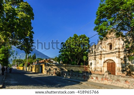 San Jose el Viejo ruins & Agua volcano in colonial city & UNESCO World Heritage Site of Antigua, Guatemala - stock photo