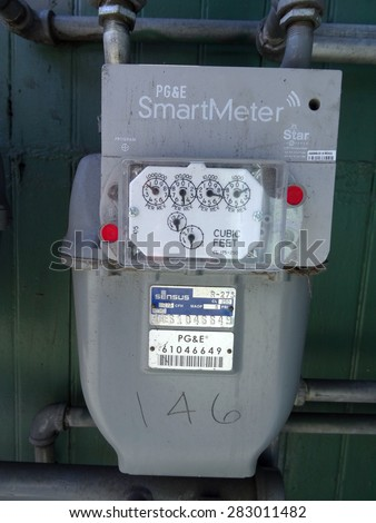 SAN JOSE - MARCH 30: PG&E (utility co)  electricity SmartMeters which monitor energy quality and provide real time energy consumption data. Assembled in Mexico. in San Jose, California March 30, 2015. - stock photo