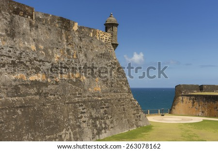 SAN JUAN, PUERTO RICO - MARCH 6, 2015: Castillo San Christobal. Northeastern Lookout tower on rampart with circular WWII cannon placement and ocean view. - stock photo