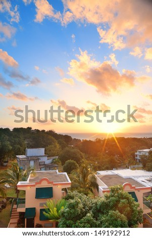 San Juan sunrise with colorful cloud, buildings and beach coastline.  - stock photo