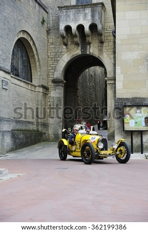 SAN MARINO, RSM - MAY 15: A yellow Bugatti T35A takes part to the 1000 Miglia classic car race on May 15, 2015 in San Marino. The car was built in 1925. - stock photo