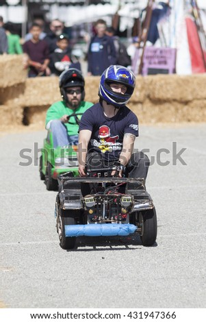 SAN MATEO, CA May 20 2016 - A driver looks ahead during a power wheels race at the 11th Annual Bay Area Maker Faire at the San Mateo County Event Center.
