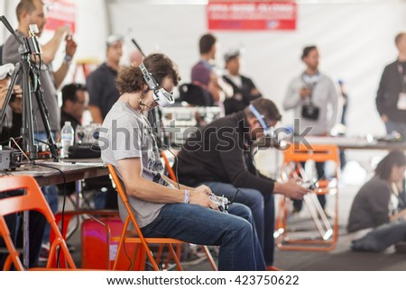 SAN MATEO, CA May 20 2016 - A drone pilot manuvers his drone through a course at the 11th Annual Bay Area Maker Faire at the San Mateo County Event Center. - stock photo