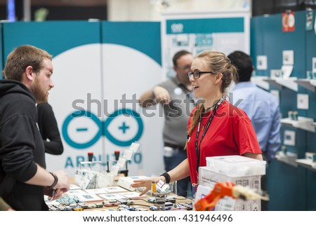 SAN MATEO, CA May 20 2016 - A young woman answers questions during the 11th annual Bay Area Maker Faire at the San Mateo County Event Center. - stock photo