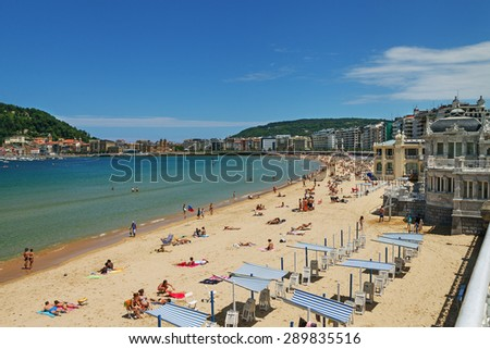 SAN SEBASTIAN or DONOSTIA, SPAIN-JUN 14: San Sebastian or Donostia is a coastal city and located on the coast of the Bay of Biscay, Spain. View to the coast in low tide on 14 Jun, 2015, Spain. - stock photo