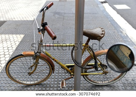 SAN SEBASTIAN, SPAIN- AUGUST 12, 2015: Retro style bikes invade the streets of the city of Donostia on August 12,2015 in Donostia,Spain.