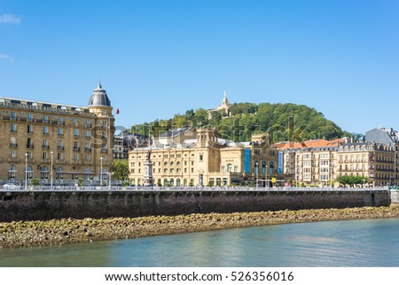 SAN SEBASTIAN, SPAIN - OCTOBER 02. View over the river Urumea to the Victoria Eugenia Theater, a neoplateresque building, a special Spanish architecture, in Donostia San Sebastian on October 02, 2016