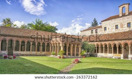 San Zeno Maggiore basilica yard in summer in Verona, Italy - stock photo