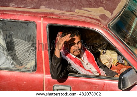 SANA'A, YEMEN - JAN 11, 2014: Unidentified Yemeni man smiles in a car. People of Yemen suffer of poverty due to the unstable political and poor economical situation