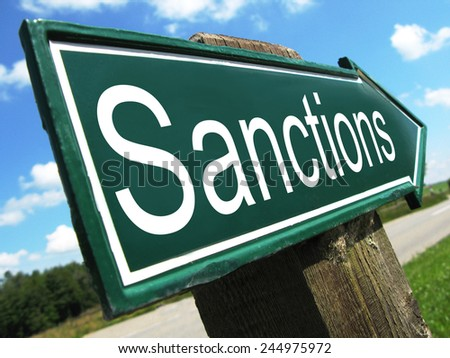 Sanctions road sign - stock photo