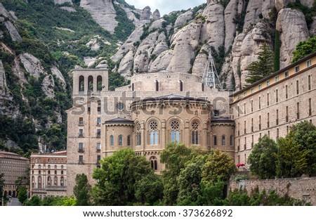 Sanctuary of Santa Maria de Montserrat Abbey in Montserrat mountains, Spain - stock photo