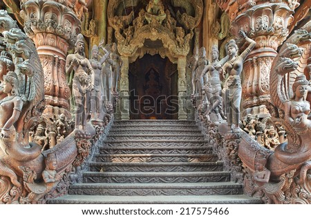 Sanctuary of Truth is a temple construction in Pattaya, Thailand. The sanctuary is an all-wood building filled with sculptures based on traditional Buddhist and Hindu motifs. - stock photo