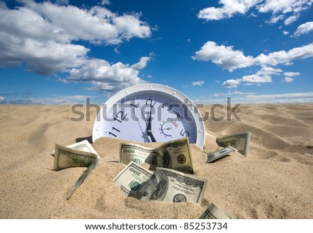 sand absorbs time and money - stock photo