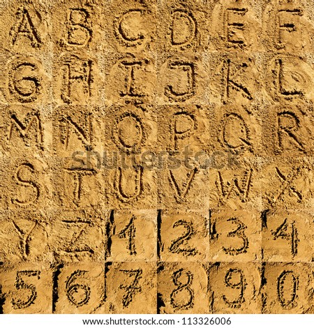 sand alphabet collection of letters and numbers - stock photo