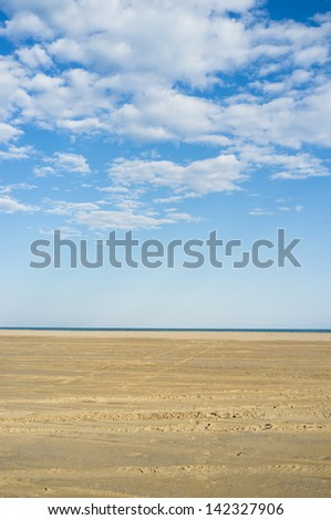 Sand and sky on a sunny day, a nature background - stock photo