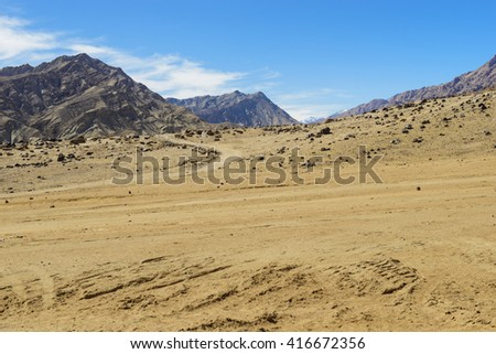 Sand and stone gives an impression of mountains - stock photo