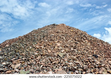 Sand and stone heap in quarry plant in Helsinki, Finland - stock photo