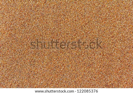 Sand at the beach as a textured background - stock photo