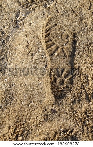 Sand background wit pattern of boot print