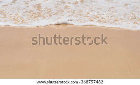 Sand background with wave. Beautiful sand background and wave from sea. Sand Texture background. Closeup of sand. - stock photo