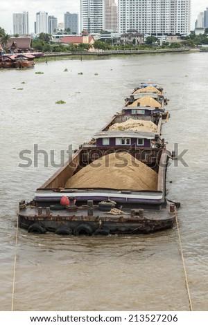 Sand barge on the Chao Phraya River in Bangkok. - stock photo
