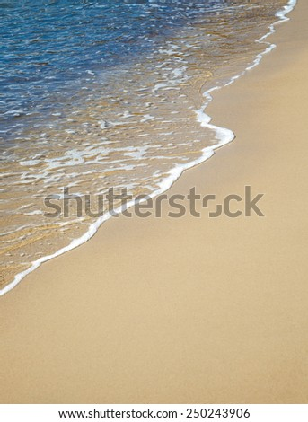 sand beach and calm water - stock photo